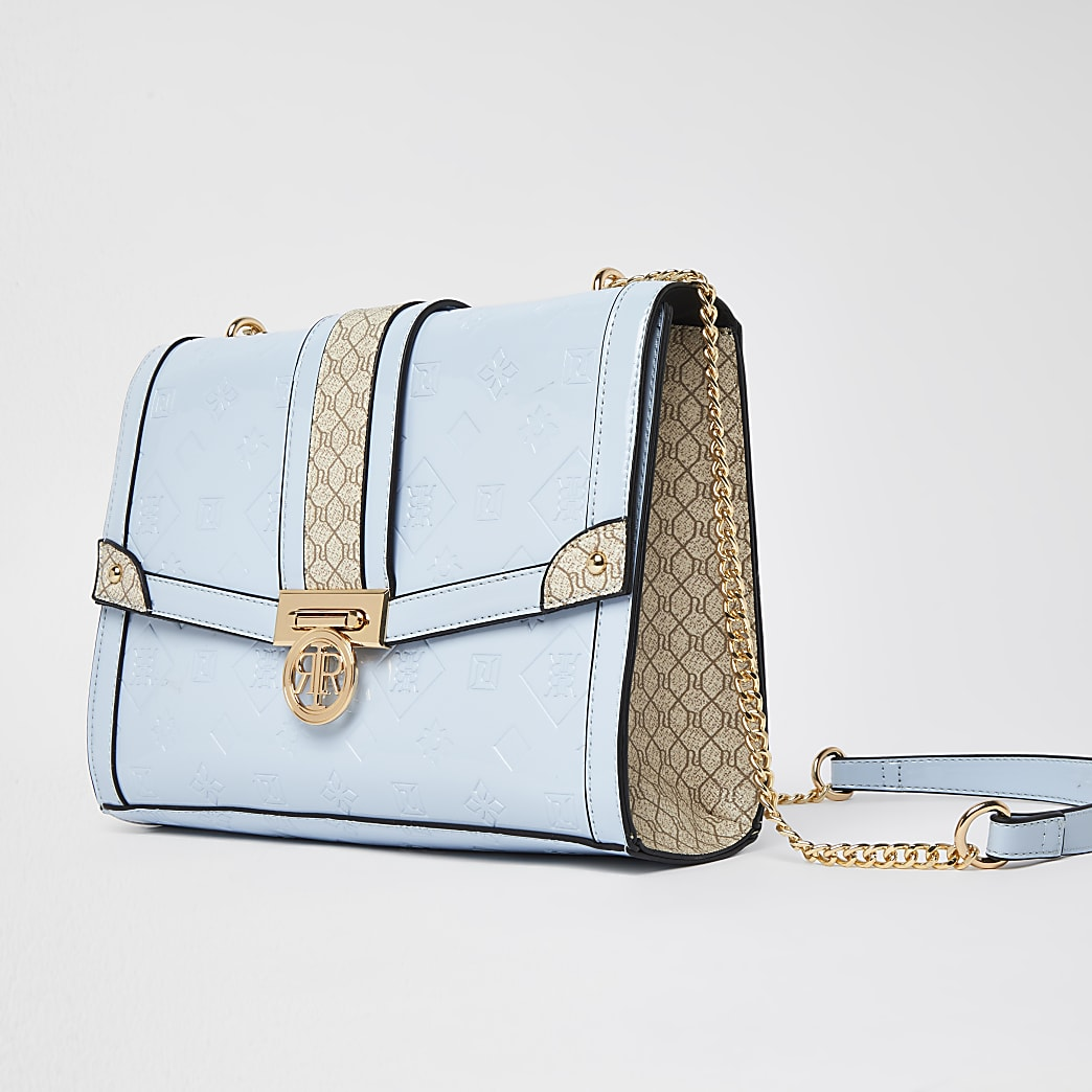 Blue patent monogram bag