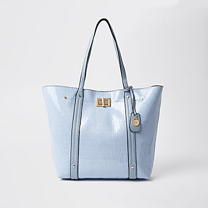 Blue patent RI embossed shopper handbag