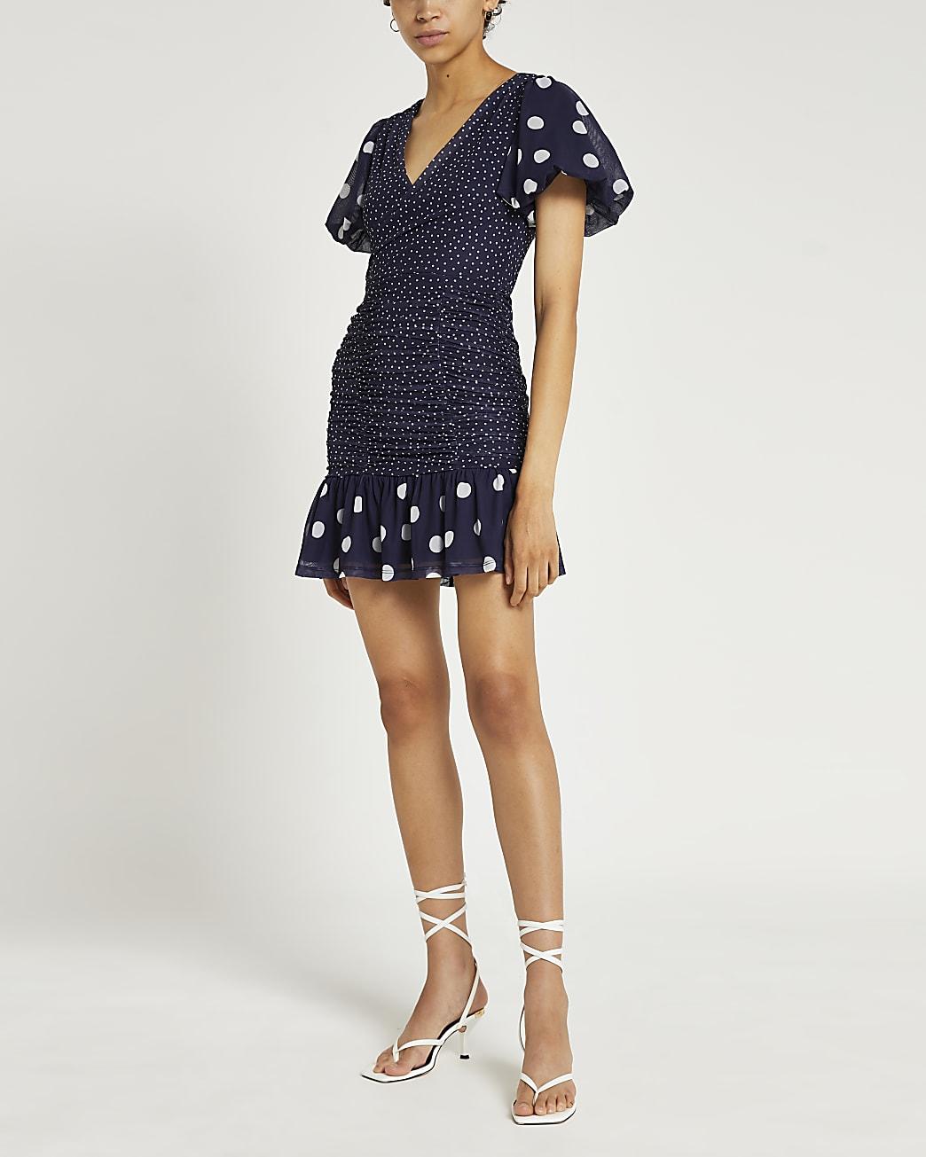 Blue polka dot shirred bodycon mini dress