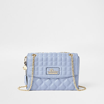 Blue quilted satchel