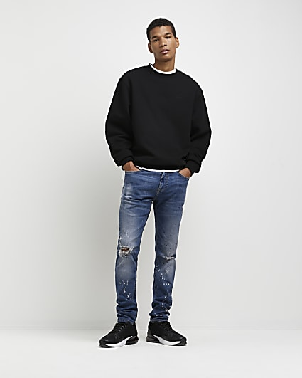 Blue relaxed skinny fit paint ripped jeans