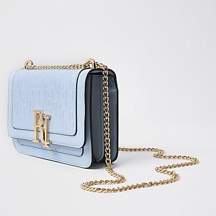Blue RI embossed underarm satchel bag