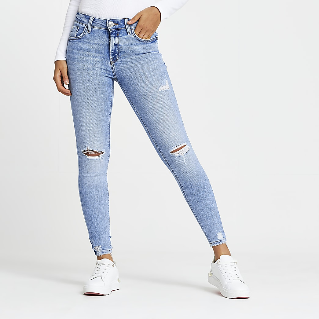 Blue ripped mid rise skinny jeans