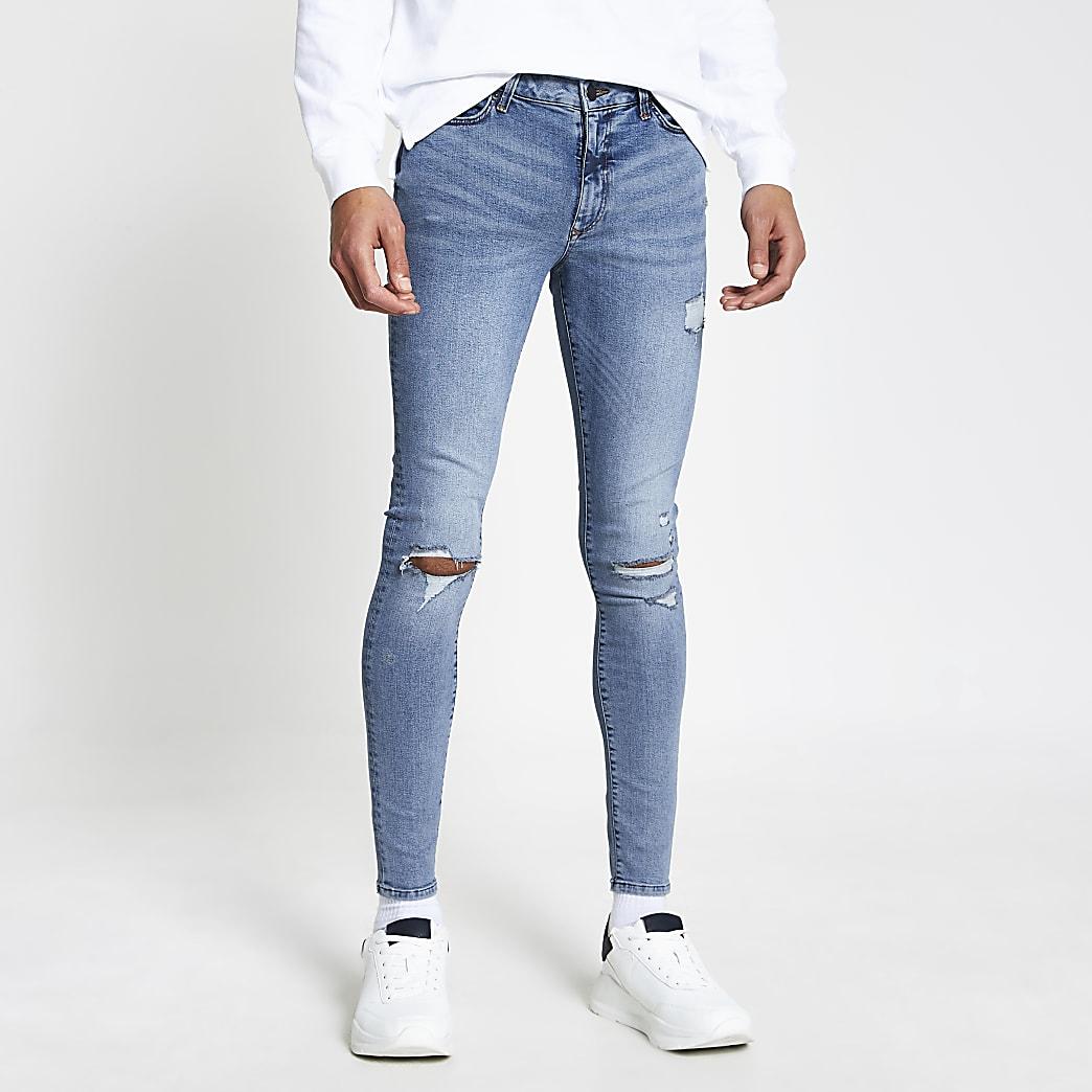 Ollie - Blauwe ripped spray-on  skinny jeans