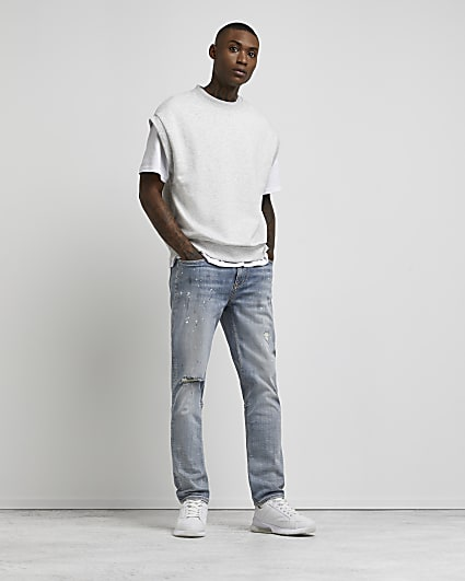 Blue ripped paint relaxed skinny fit jeans