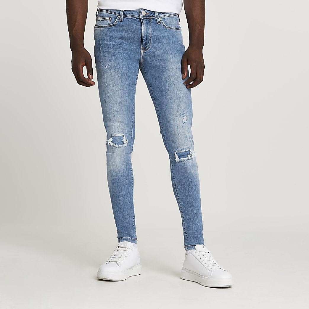 Blue ripped spray on skinny fit jeans