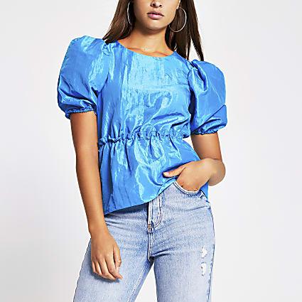Blue short sleeved taffeta peplum top