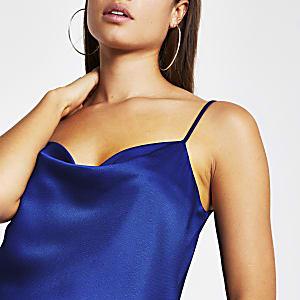 Blauwe mouwloze cami met losvallende col