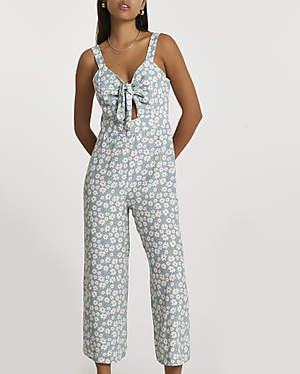 Blue sleeveless floral front tie jumpsuit