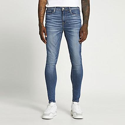 Blue spray on skinny jeans