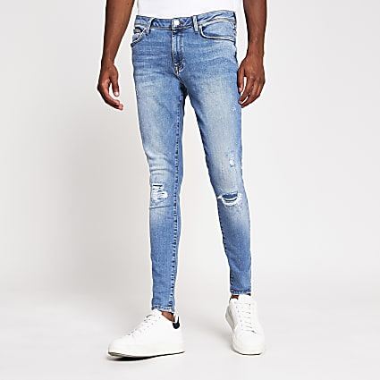 Blue spray on skinny ripped jean