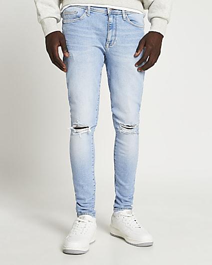 Blue spray on super skinny jeans