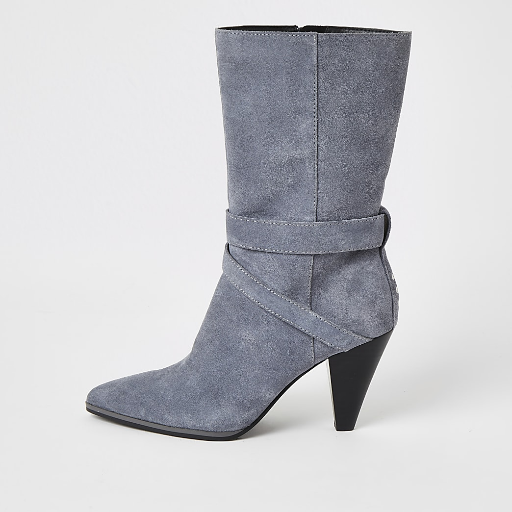 Blue suede strap heeled boots