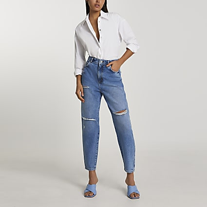 Blue tapered high waisted ripped jeans