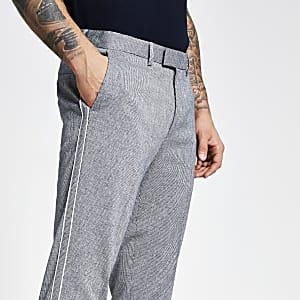 Blauwe skinny broek met textuur en bies aan zijkant