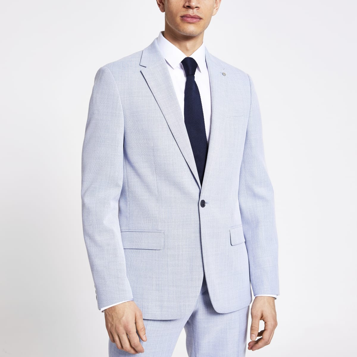 Blue textured slim fit suit jacket