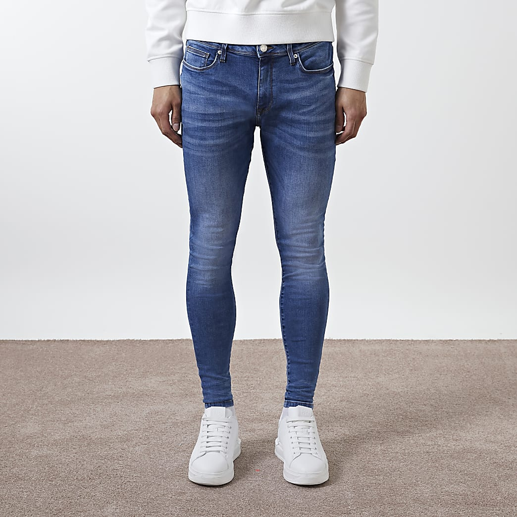 Blue washed Ollie spray on skinny jeans