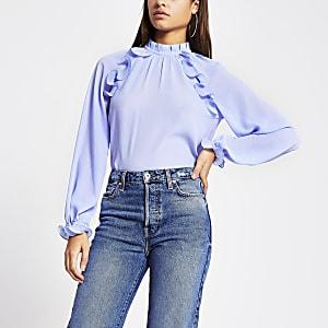 Blauwe doorschijnende blouse met ruches en lange mouwen