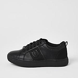 Zwarte sneakers met leeuw reliëf en vetersluiting voor jongens