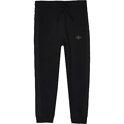 Boys black pique Maison Riviera tape joggers