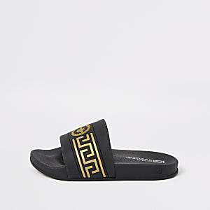Zwarte slippers met wespembleem in reliëf voor jongens