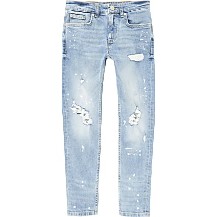 Boys blue ripped paint splat skinny jeans