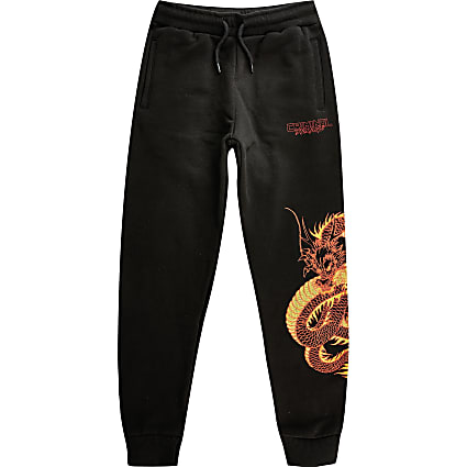 Boys Criminal Damage black dragon joggers