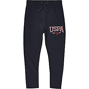 U.S. Polo Assn. - Marineblauwe joggingbroek met merkprint voor jongens