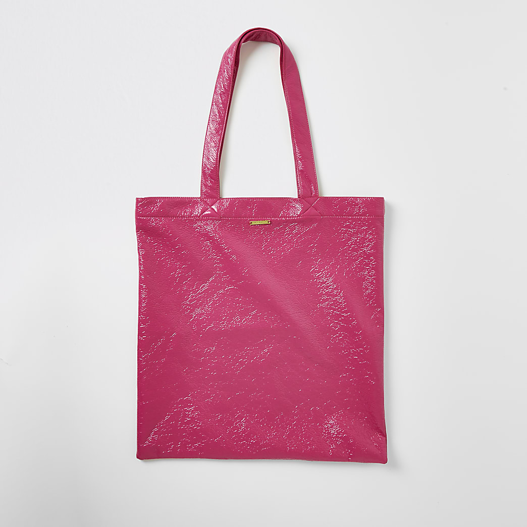 Bright pink patent textured tote bag