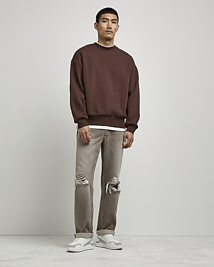 Brown baggy fit ripped jeans