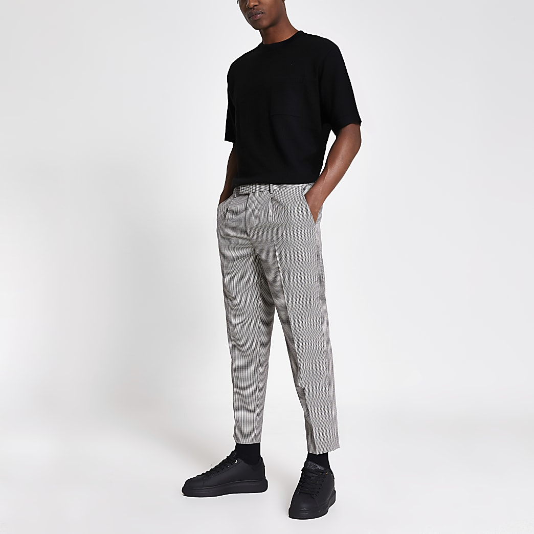Brown dogtooth check pleated trousers