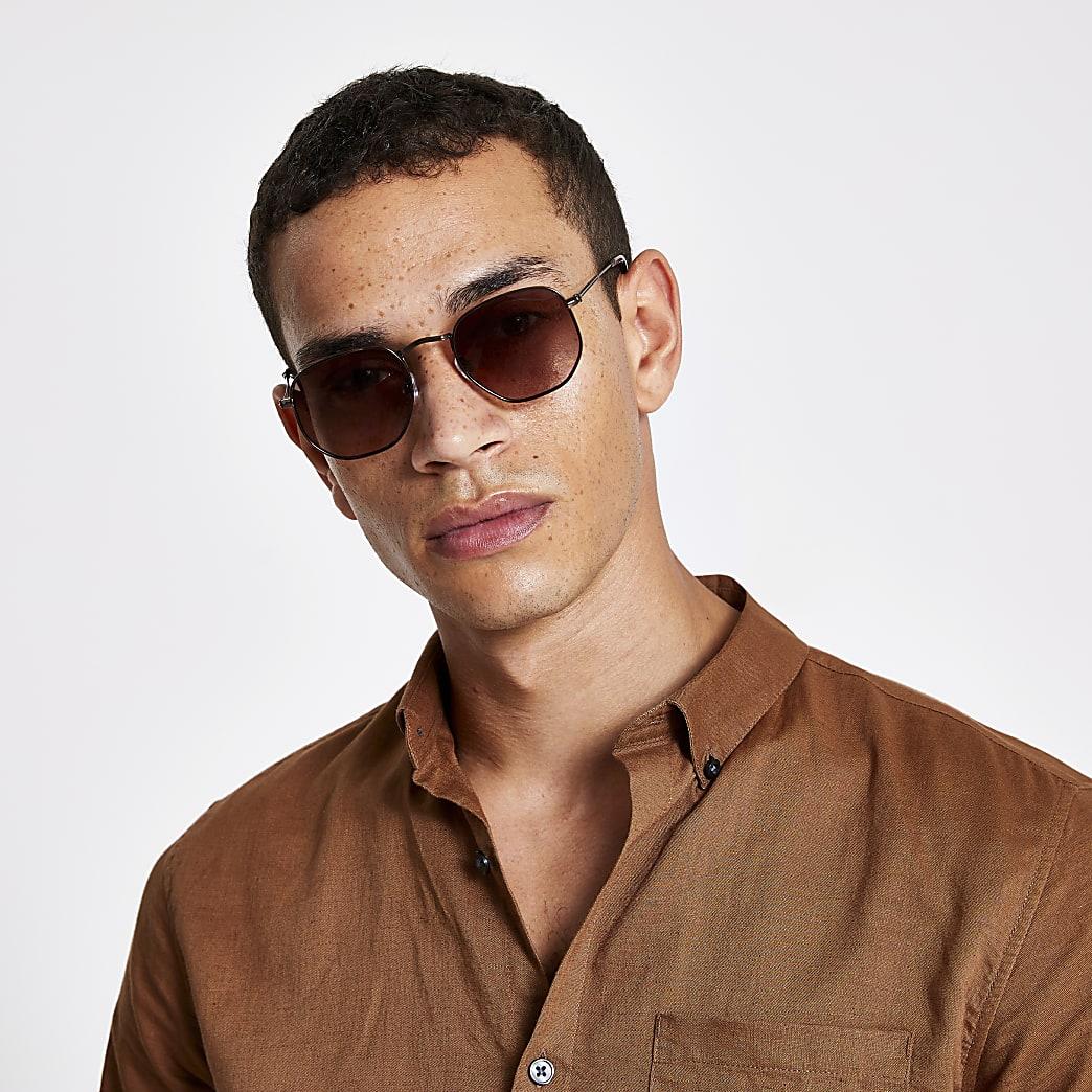 Bruine zonnebril met zeshoekig montuur