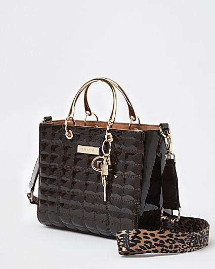 Brown patent tote bag