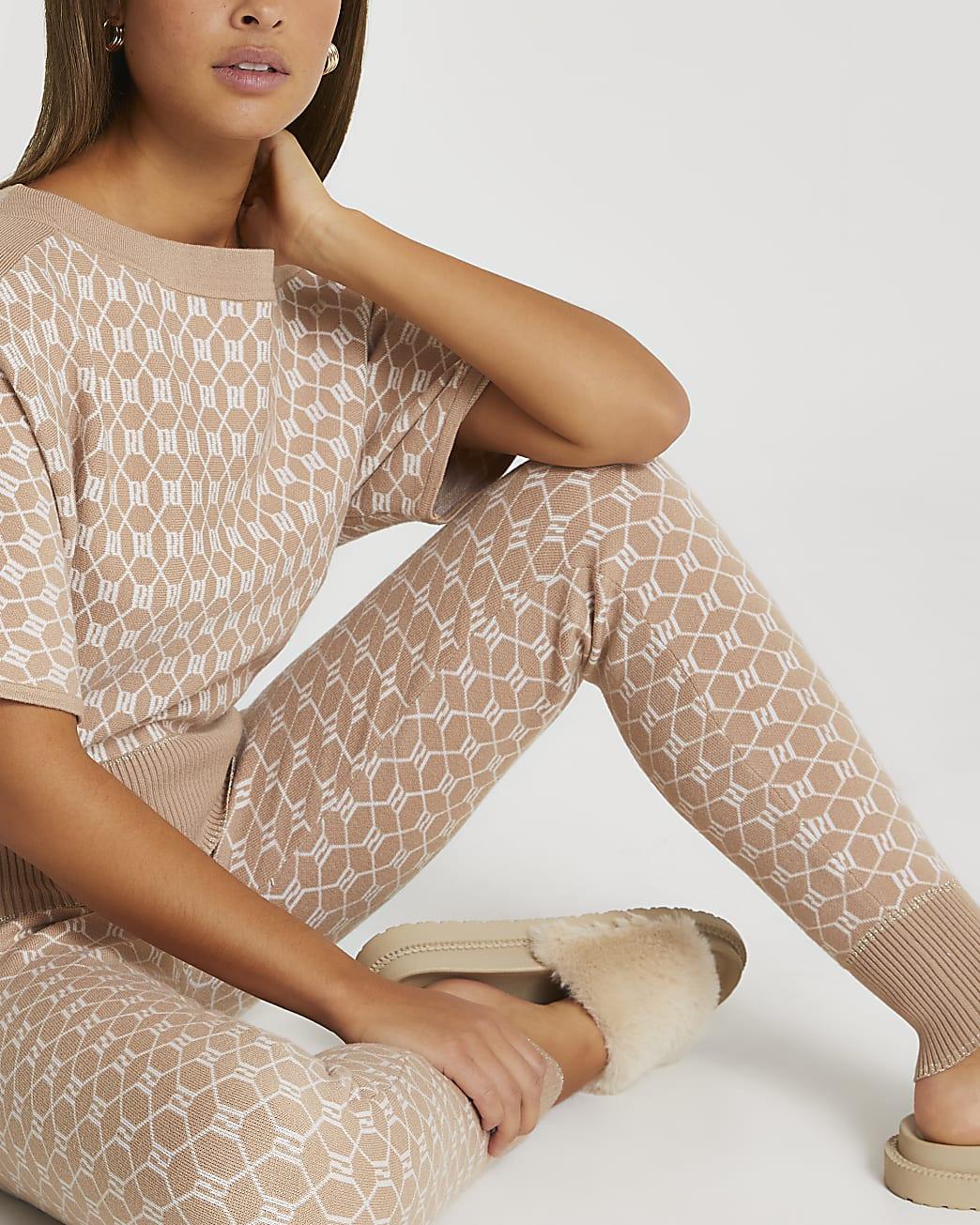 Brown RI monogram knitted asymmetric jumper