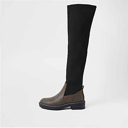 Brown RI monogram knitted high leg boots