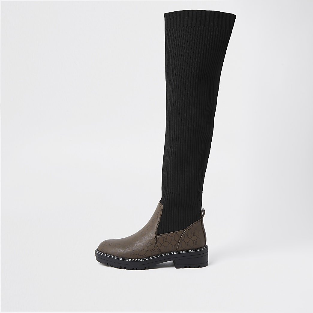 Brown RI monogram knitted high leg boots