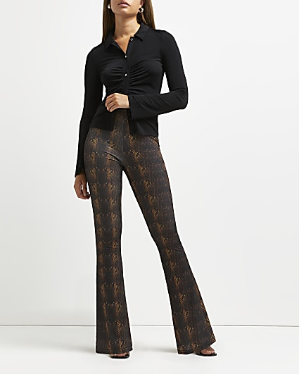Brown snake print flared trousers