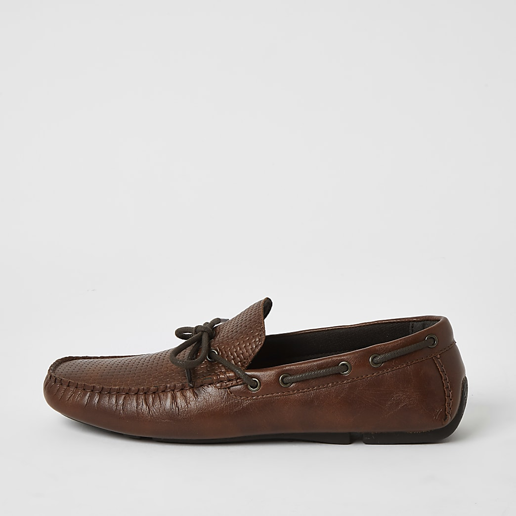 Brown textured tie front boat shoes