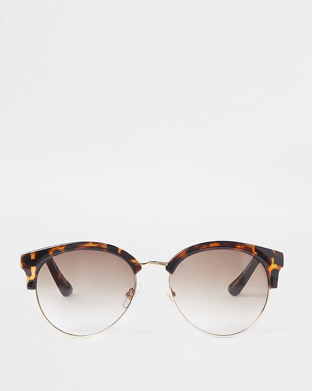 Brown tortoiseshell chain trim sunglasses