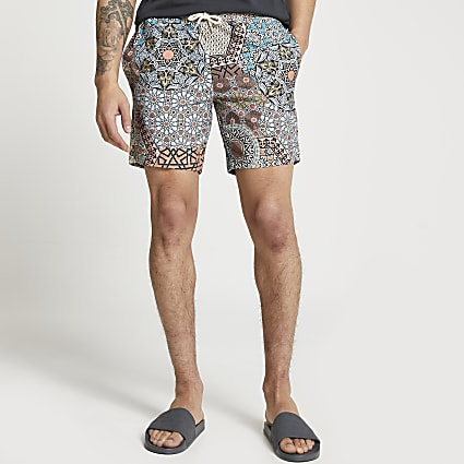 Coral tile print swim shorts