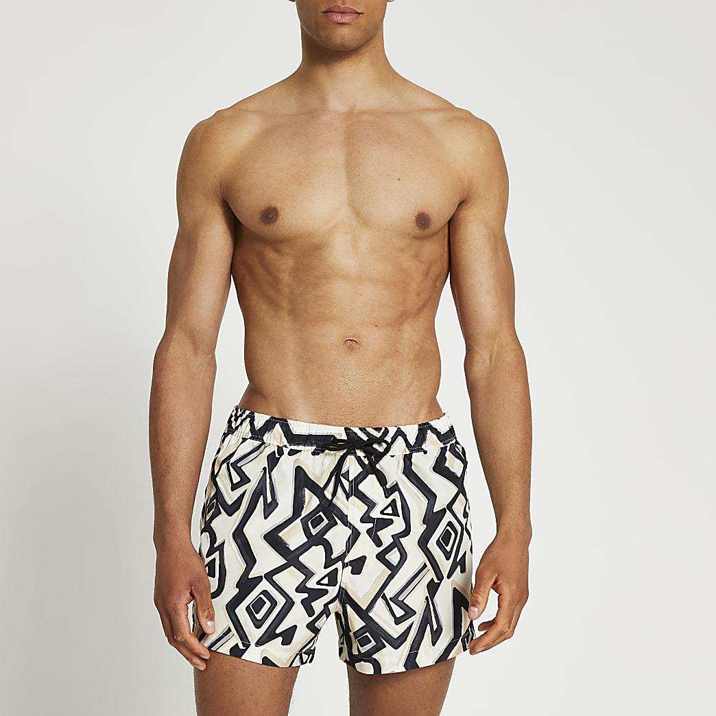 Cream abstract print swim shorts