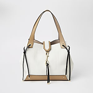 Cream and tan clip front slouch bag