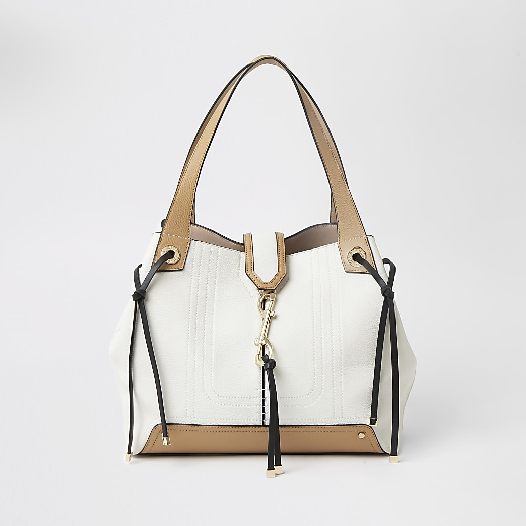 Cream and tan clip front slouch Handbag