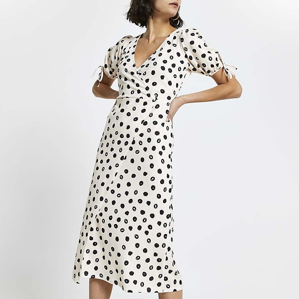 Cream asymmetric wrap midi spot print dress