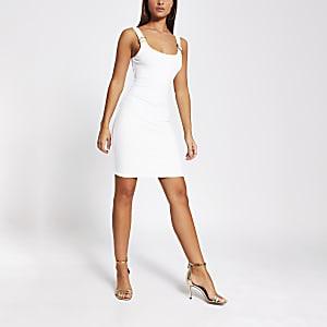 Cream buckle strap bodycon mini dress