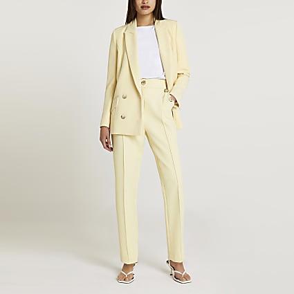 Cream button detail peg leg trousers