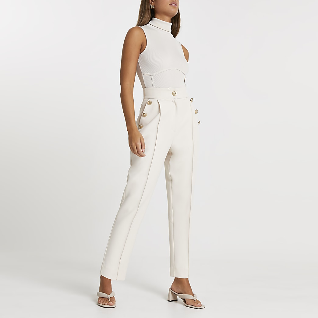 Cream button front peg trousers