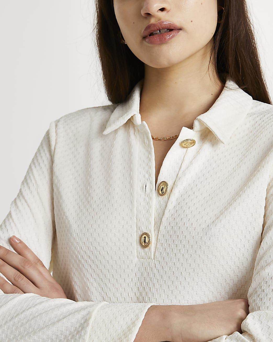 Cream buttoned long sleeve polo shirt