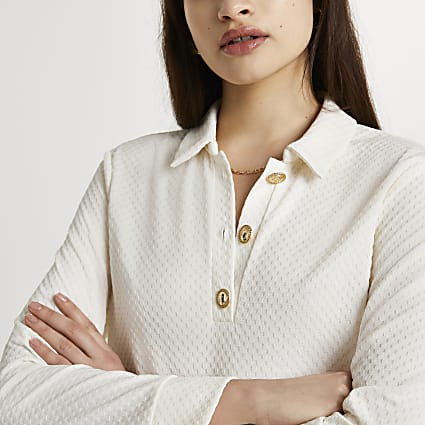 Cream buttoned long sleeve polo shirt