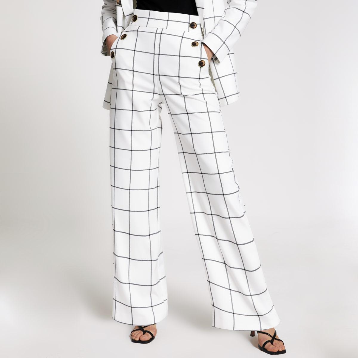 Pantalon large crème à carreaux avec boutons